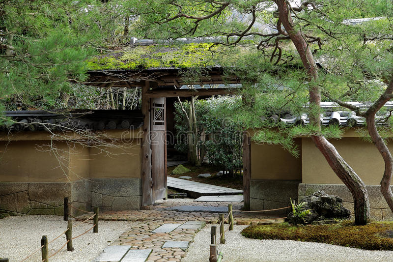 Entrance of ancient Japanese house. With stone path and pine tree stock photography