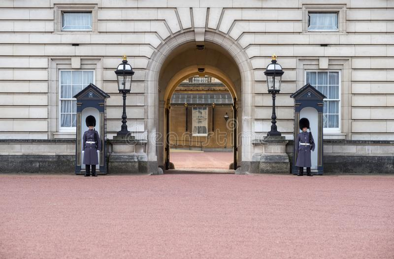 Ehentrance of Buckingham Palace - England - United Kingdom - with unrecognizable Welsh Guards in blue uniform standing guard and. Entrance of Buckingham Palace stock photo