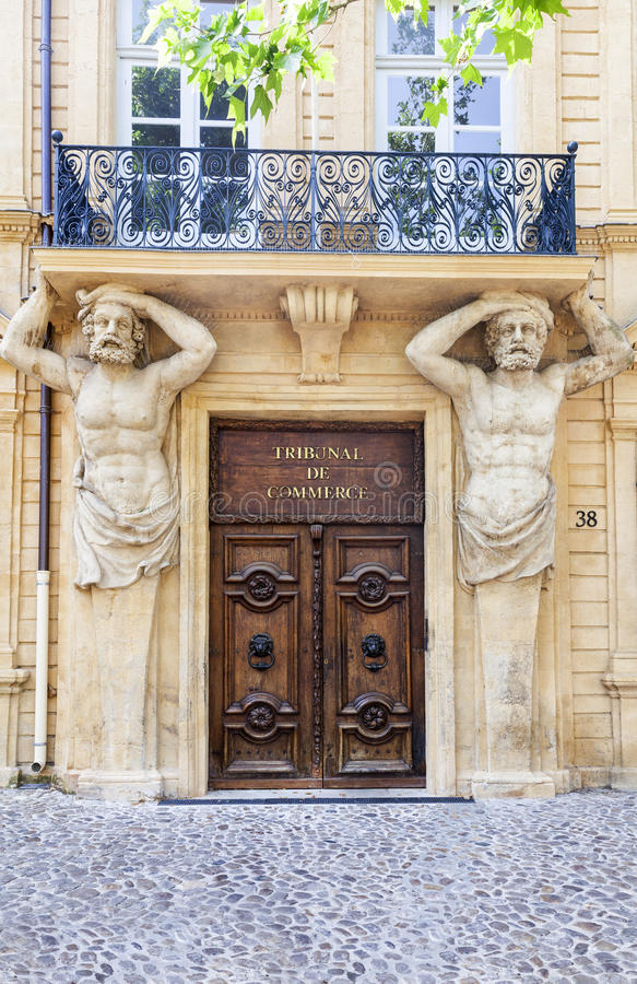 Entrance of the commercial court with statues in Aix en Provence stock image