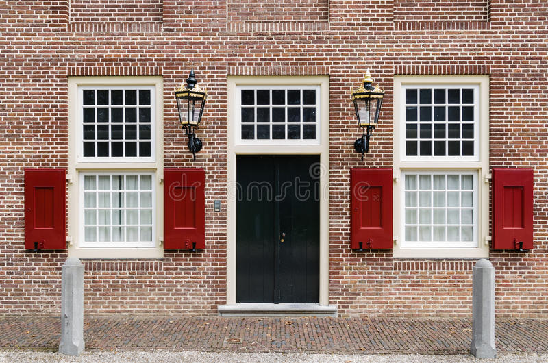 Entrance door with 2 windows and lanterns
