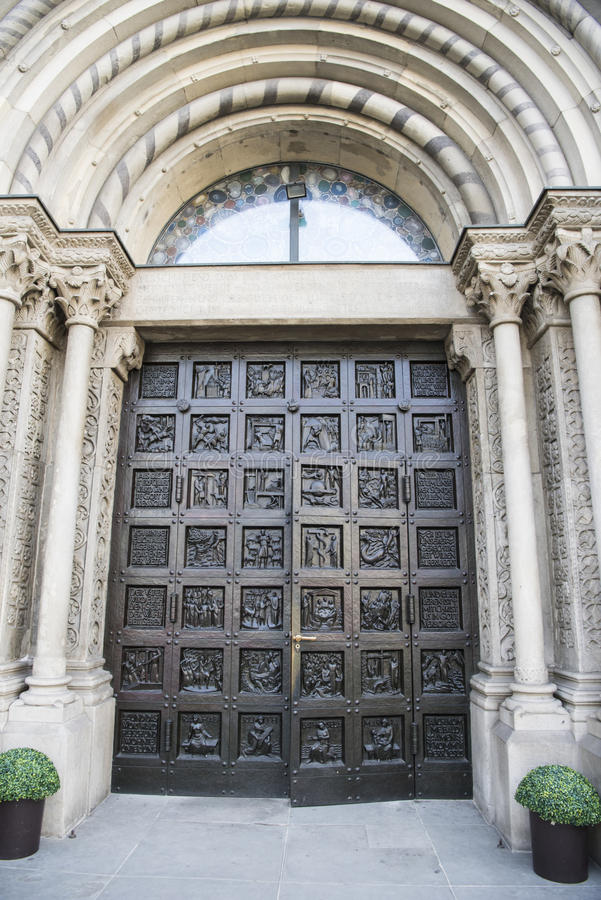 Entrance Door Church Grossmunster, Zurich stock photos