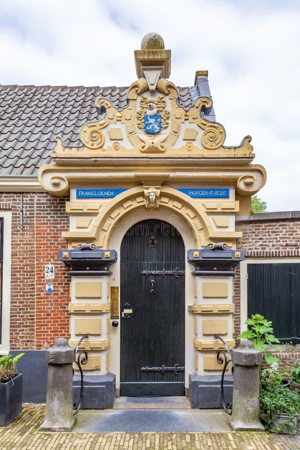 Entrance door Frans Loenen Hofje in Haarlem in the Netherlands stock photography