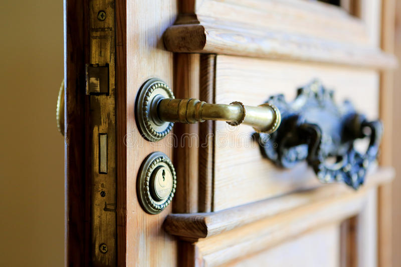 Entrance door handle with keyhole. Close up view royalty free stock photos