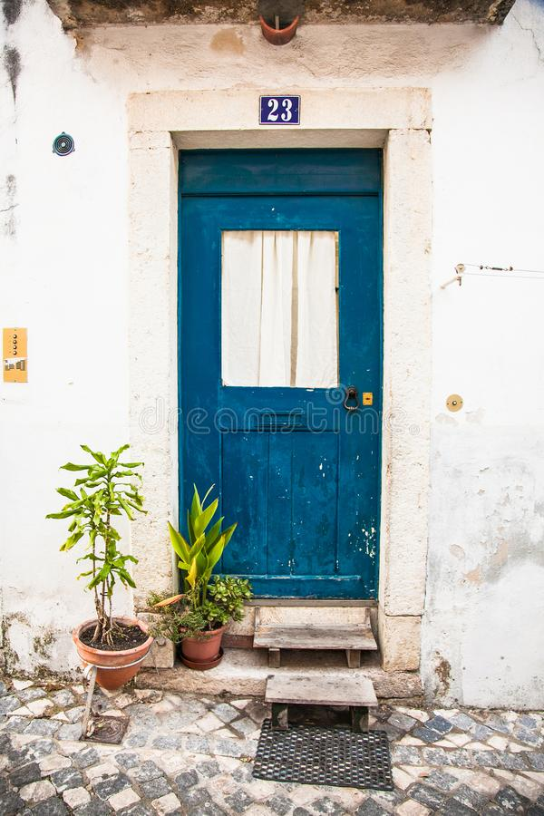 Entrance door in the old house of the historic quarter in Lisbon, Portugal stock photo