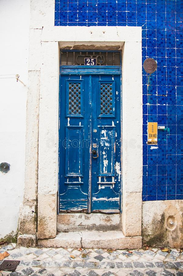 Entrance door in the old house of the historic quarter in Lisbon, Portugal stock photography
