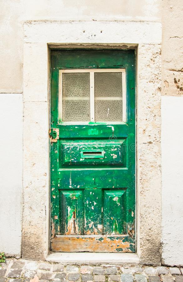 Entrance door in the old house of the historic quarter in Lisbon, Portugal stock photos
