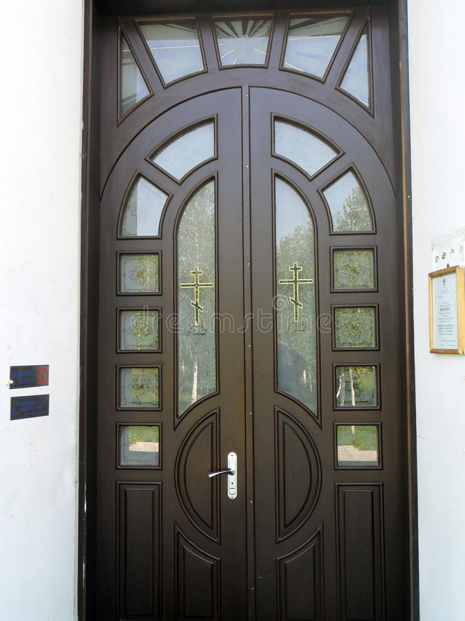 Entrance door to Christian church stock photography