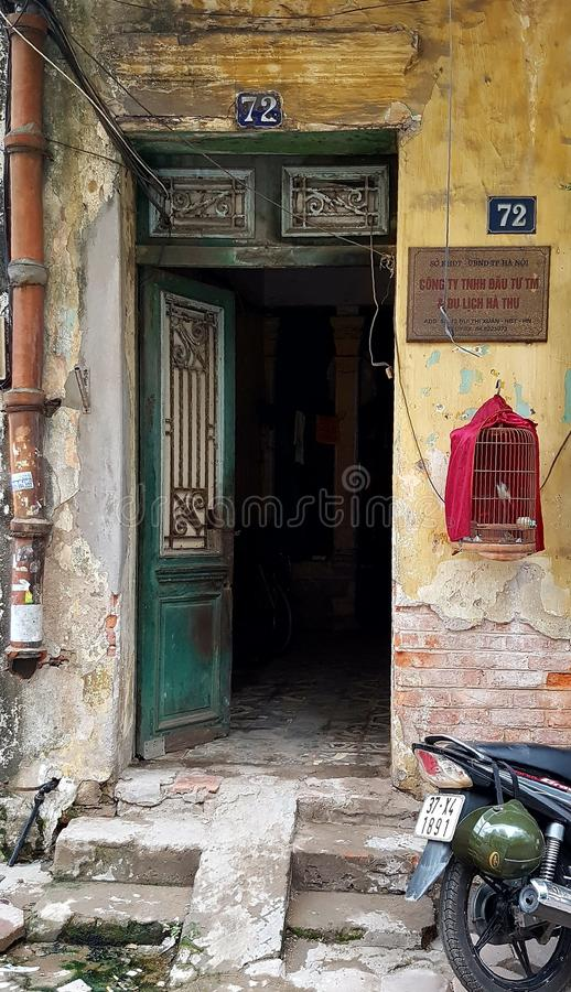 Entrance door to house in Old Quarter of Hanoi stock photo