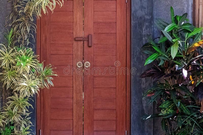 Entrance door to the villa with garden stock photo