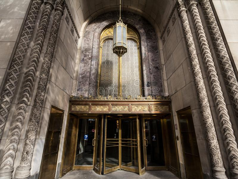 Entrance of the Edifice Dominion Square Building on Sainte Catherine Street with its old revolving doors. stock photos