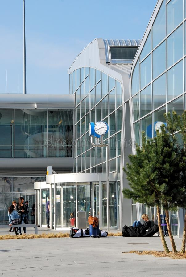 Entrance Eindhoven Airport arrival and departure hall - Netherlands. Entrance arrival and departure hall Eindhoven Airport with waiting traveling people stock image