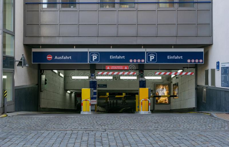 Entrance and exit of a car park. With the german words `Ausfahrt` and `Einfahrt` means `Exit` and `Entrance royalty free stock images