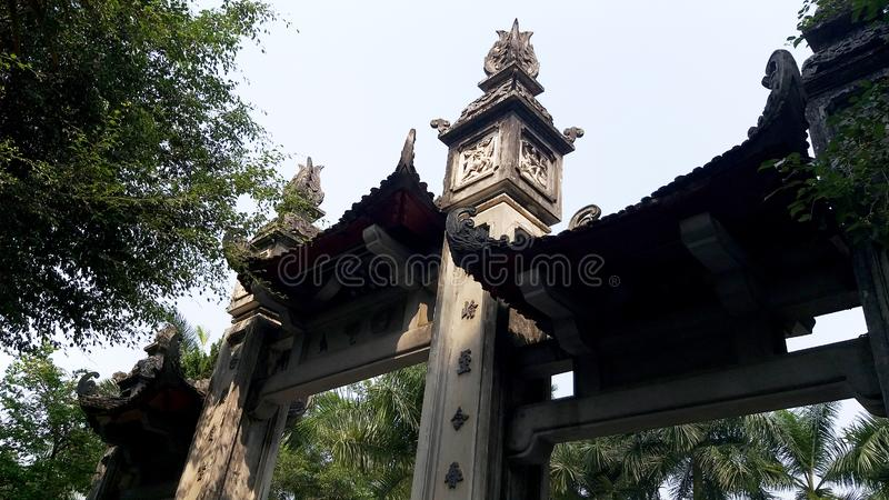 The entrance and exit of a temple. With its unique ancient architecture, is surrounded by ancient trees in harmony with the landscape here royalty free stock photos
