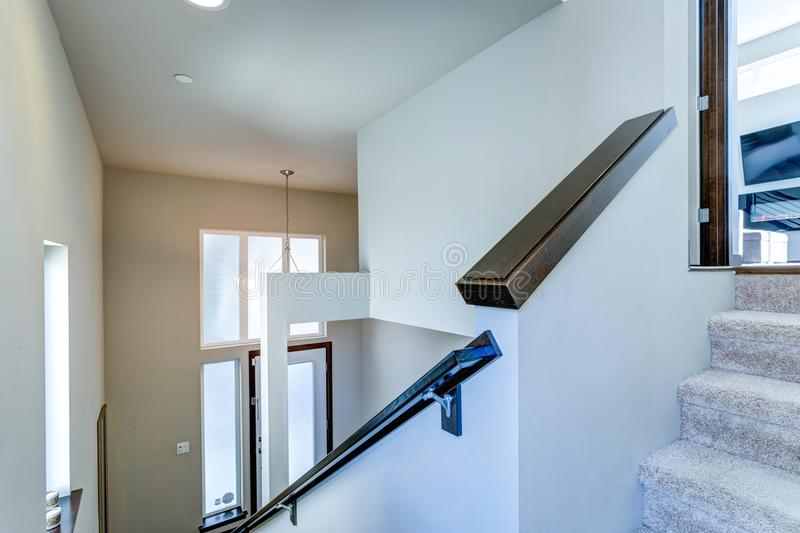 Entrance foyer with white walls and staircase. Entrance foyer with white walls and staircase of two level apartment stock images