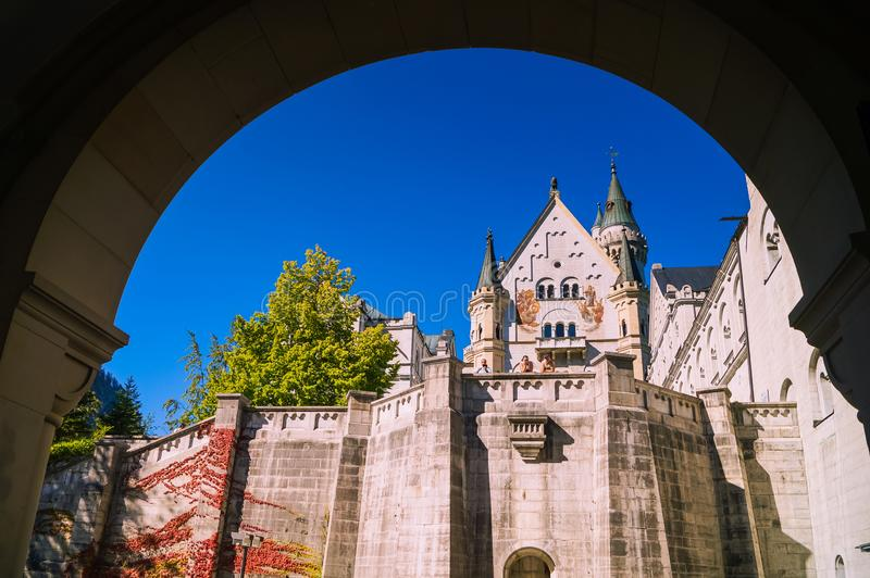 Through the entrance gate of Neuschwanstein Castle. royalty free stock photography