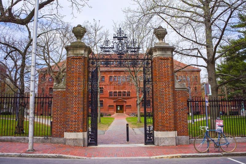 Entrance gate and Sever Hall at Harvard Yard in Cambridge. Entrance gate and East facade of Sever Hall at Harvard Yard in Harvard University in Cambridge royalty free stock photos