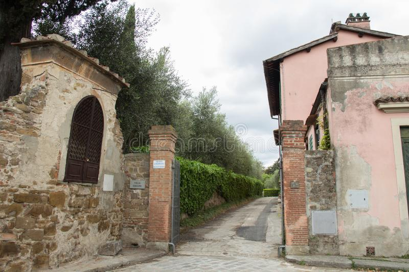 Entrance gate to typical Italian house Villa Chiappi, Florence, Italy royalty free stock photos