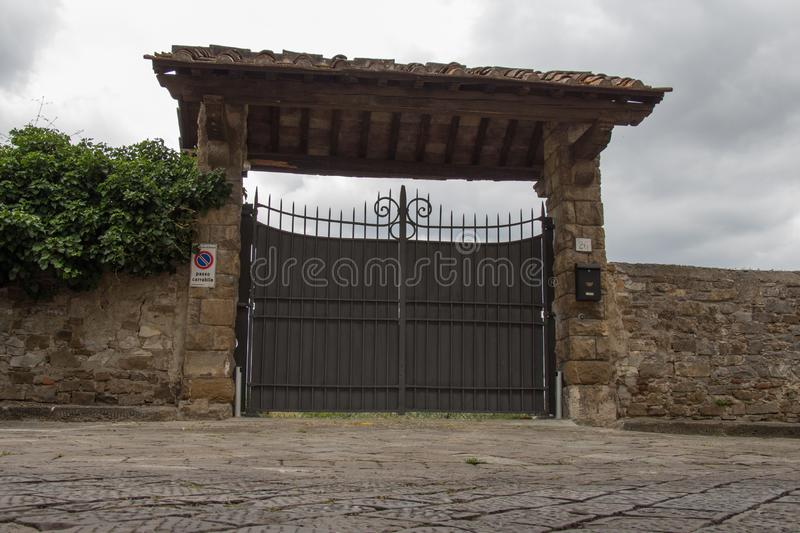 Entrance gate to typical Italian villa house, Florence, Italy royalty free stock photos