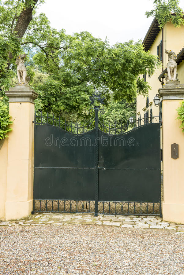 Entrance gate of an italian villa. Entrance door of a noble villa in Italy royalty free stock images