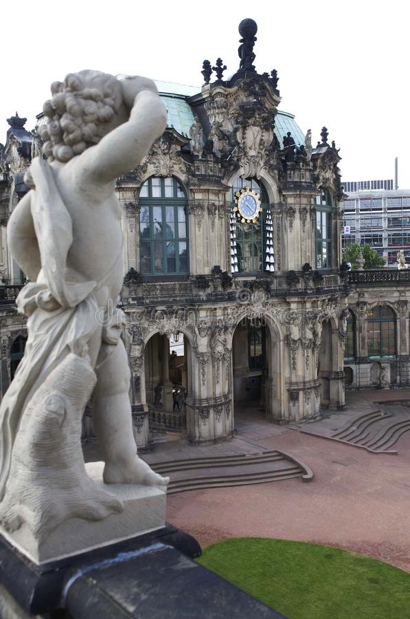 Entrance of the German Dresden Zwinger palace with a white marble statue on the front stock photos
