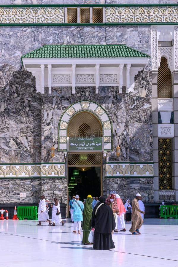 Muslim Pilgrims At The Entrance of The Great Mosque Of Mecca. royalty free stock photo