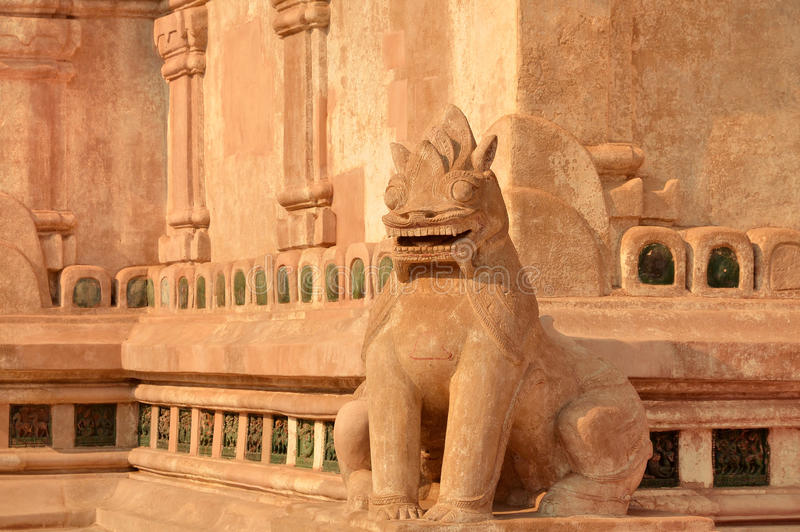 Entrance guardian Lion on the facade of Ananda Temple stock photography