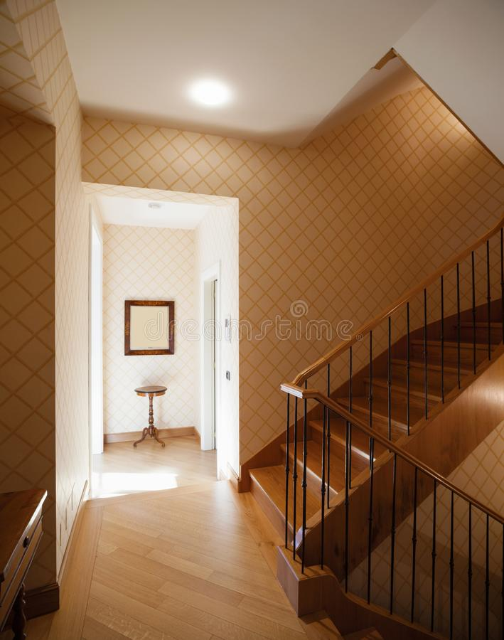 Entrance with large wooden staircase stock photography