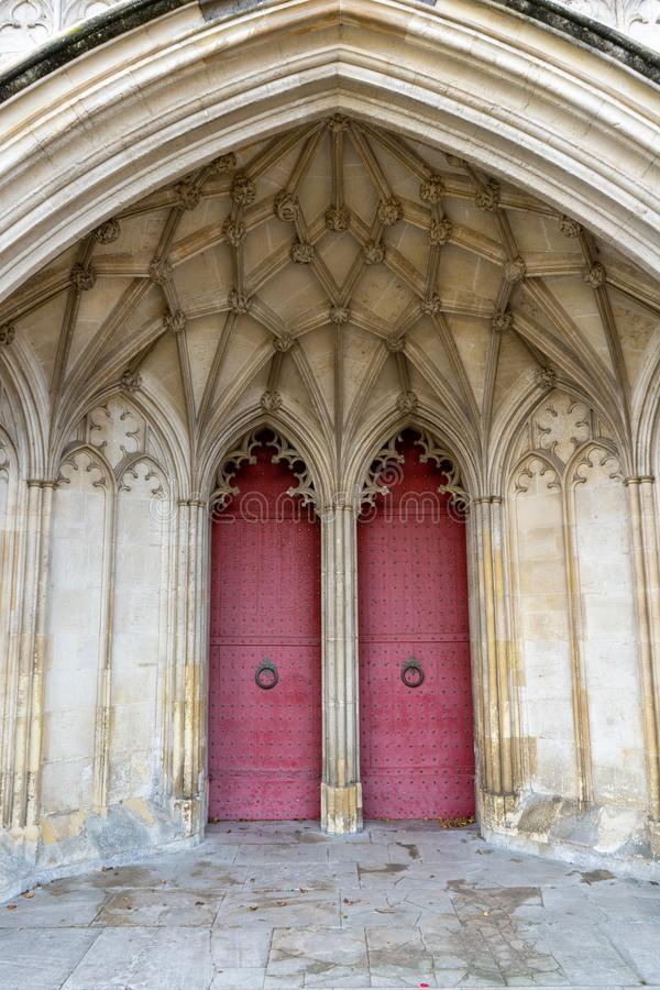 The entrance or main doors to an old English cathedral designed in the Gothic style stock photography