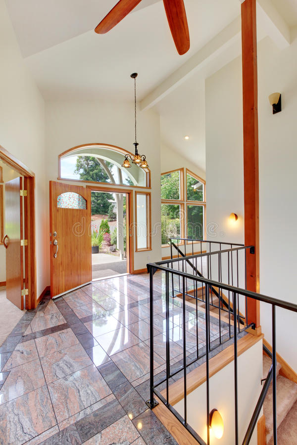Entrance with marble floor high ceiling and door stock images