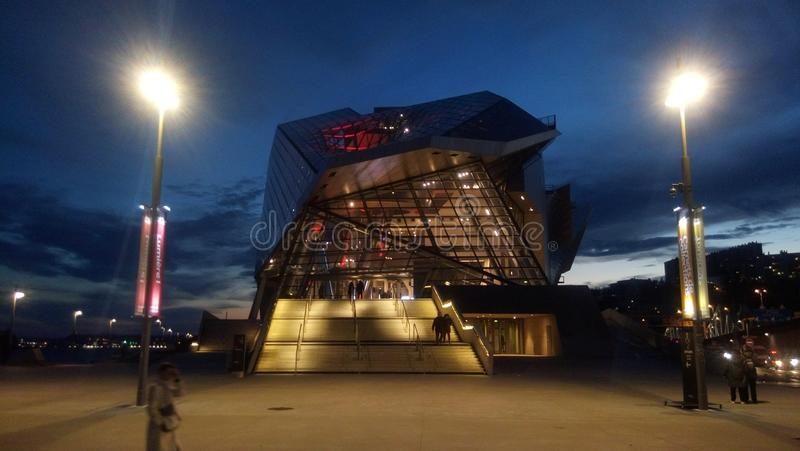 Entrance of the museum of Confluences at night, Lyon, France royalty free stock photography