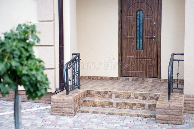The entrance of a new modern house outside view. Decorated with royalty free stock image