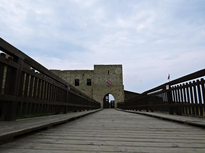 Entrance over Bridge to Medieval Castle Tower with Gate royalty free stock photos