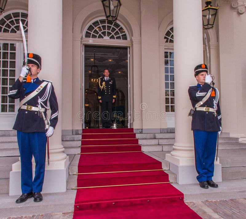 Entrance palace guards swords elegance vip visit king the hague red carpet entrance official. The Hague, Netherlands - september 23 2013 : guards are standing stock images