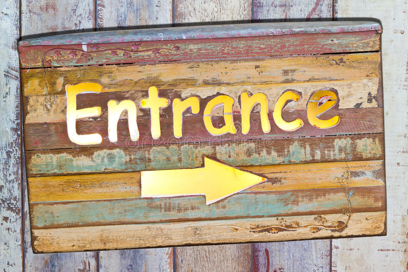 Entrance plate. On wooden board royalty free stock images