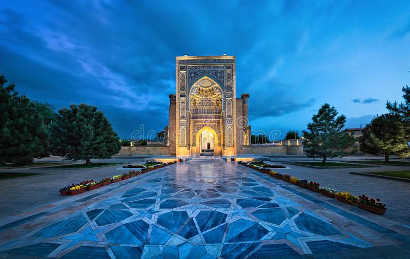 Entrance portal to Gur-e-Amir mausoleum in Samarkand, Uzbekistan. Entrance portal to Gur-e-Amir - a mausoleum of the Asian conqueror Timur also known as stock images
