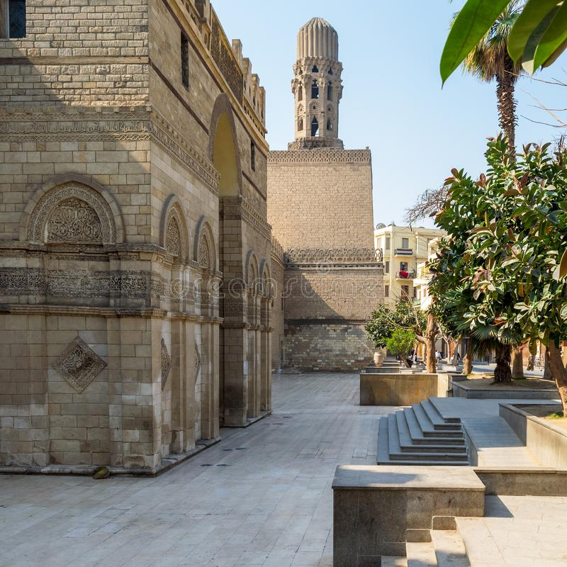 Entrance of public historic Al Hakim Mosque - Enlightened Mosque - and Minaret, Moez Street, Cairo. Cairo, Egypt- March 21 2015: Entrance of public historic Al stock photo