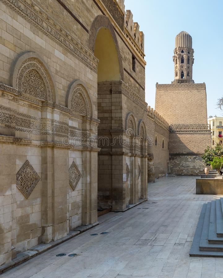 Entrance of public historic Al Hakim Mosque - Enlightened Mosque - and Minaret, Moez Street, Cairo. Entrance of public historic Al Hakim Mosque known as The royalty free stock photos