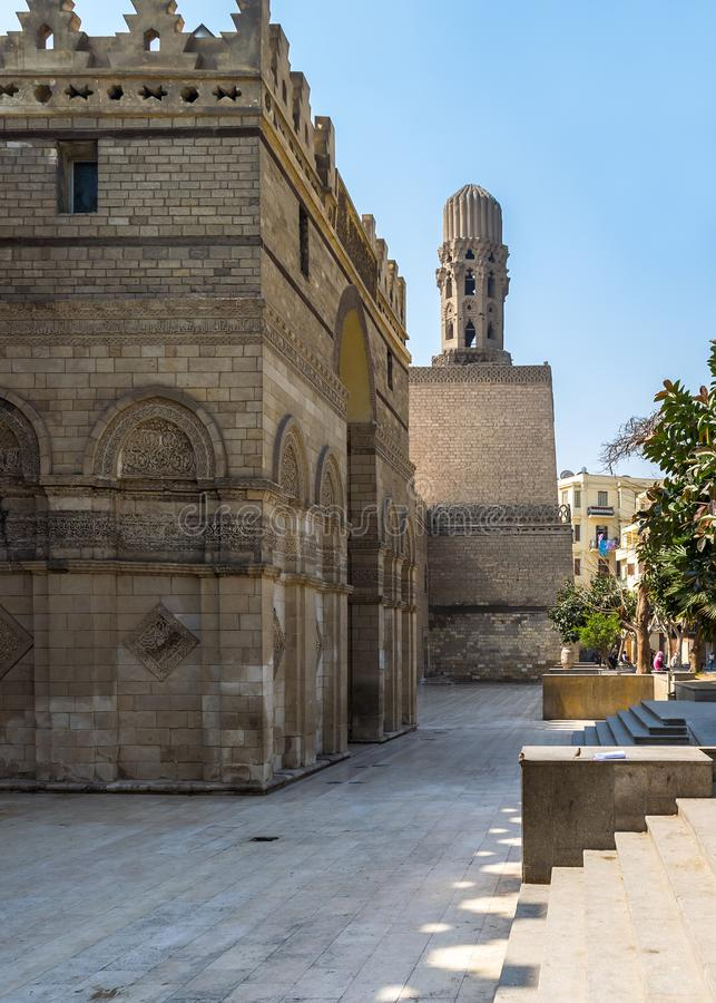 Entrance of public historic Al Hakim Mosque - Enlightened Mosque - and Minaret, Moez Street, Cairo. Cairo, Egypt- March 21 2015: Entrance of public historic Al royalty free stock photography
