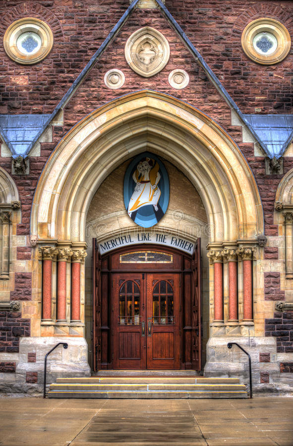 Entrance roman catholic church cathedral stock photo image 64637998 for Exterior glass doors for churches