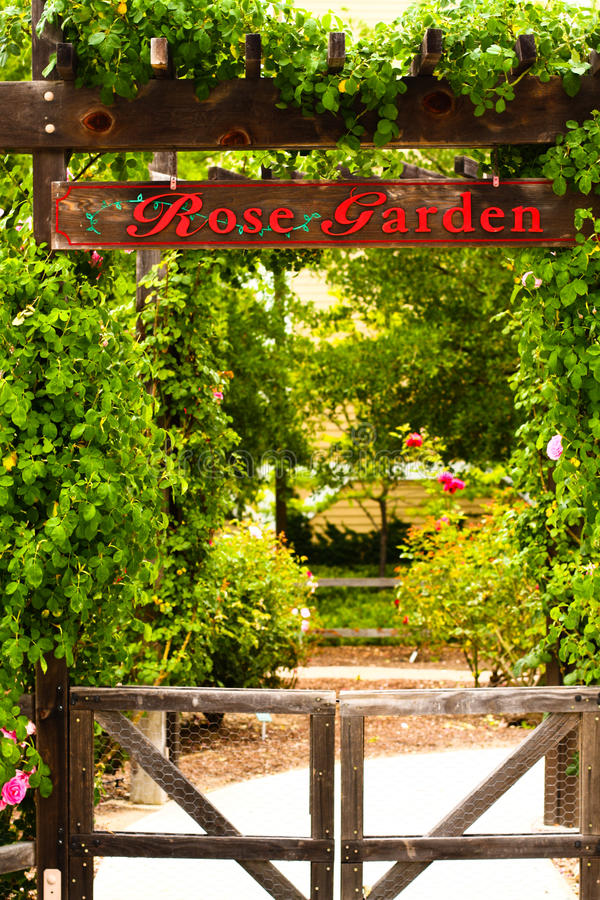 Entrance sign stating Rose Garden royalty free stock photography