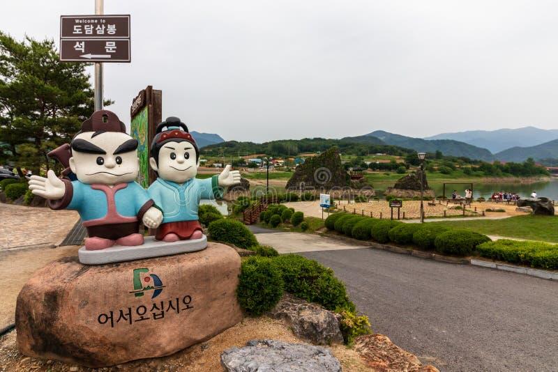 Entrance sign to Dodamsambong Peaks. Three stone peaks rising out of the Namhangang River. Danyang, North Chungcheong, South Korea. Eulwangni Beach in Incheon royalty free stock image