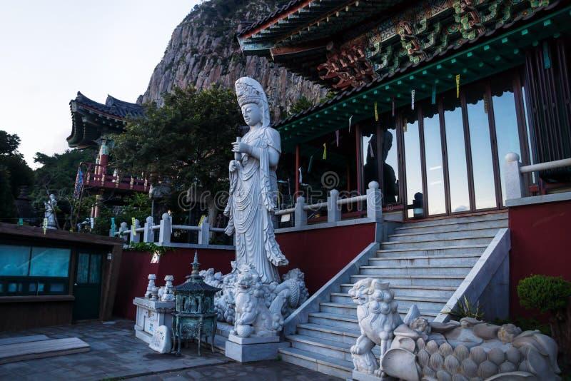 Entrance and Statua at Sanbanggulsa temple after sunset, Sanbang-ro, Jeju Island, South Korea royalty free stock photography