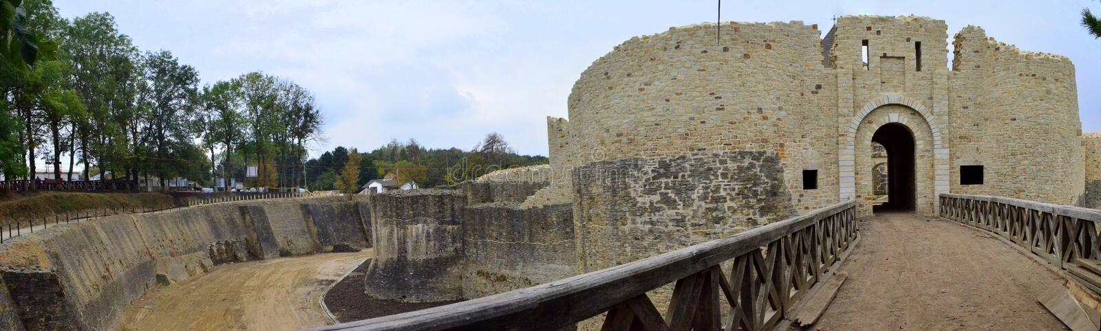 Entrance into the Suceava fortress - Romania. Image of Suceava's fortress ruins, a romanian landmark built by Stefan cel Mare - entrance through a wooden bridge royalty free stock images