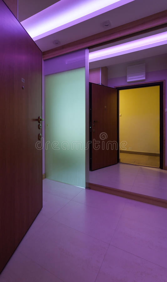 Entrance to apartment with modern lighting. Entrance to apartment with modern neon lighting stock images