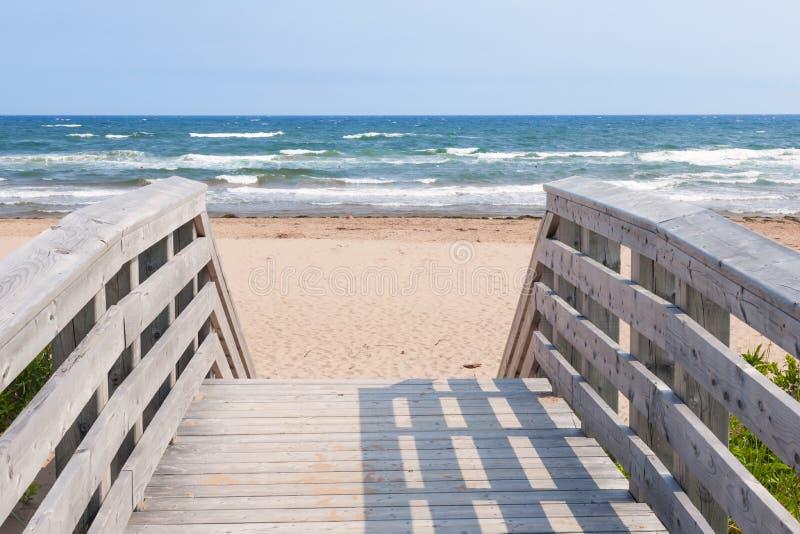 Entrance to Atlantic ocean beach. Wooden overpass leading to Atlantic beach in Prince Edward Island, Canada stock photos