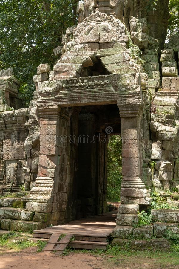 Entrance to Banteay Kdei temple in forest royalty free stock photography