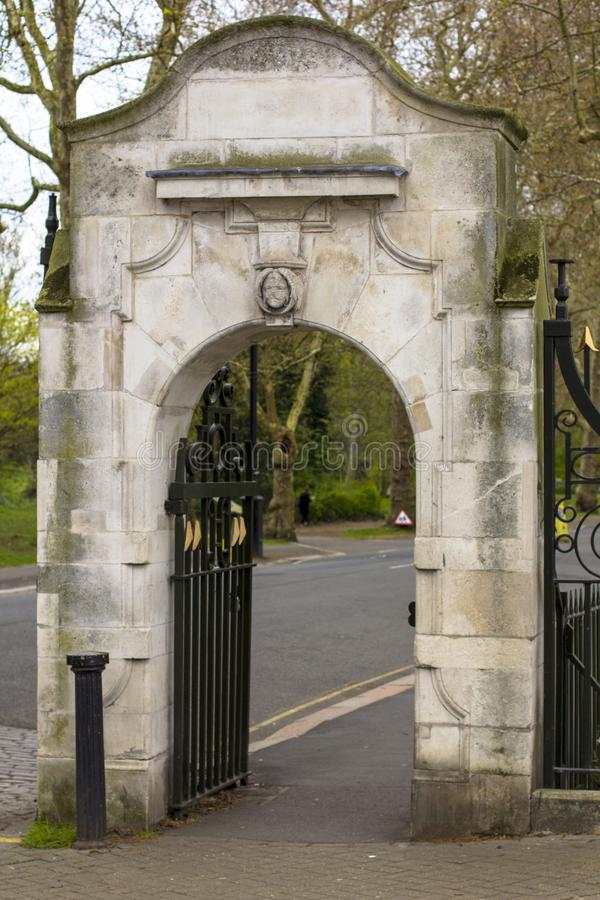 Entrance to the Battersea Park. Vintage stone gate. London, Great Britain royalty free stock photo