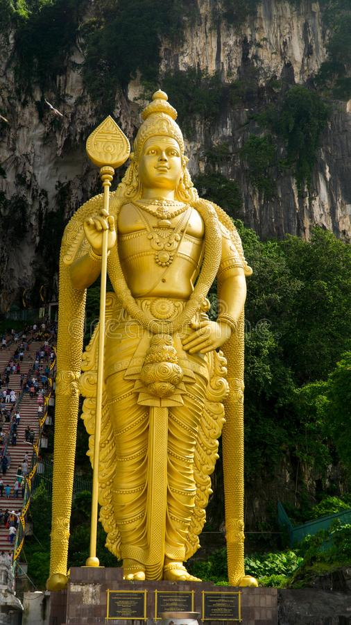 Golden Buddha statue in front of entrance to Batu Cave, Malaysia stock image