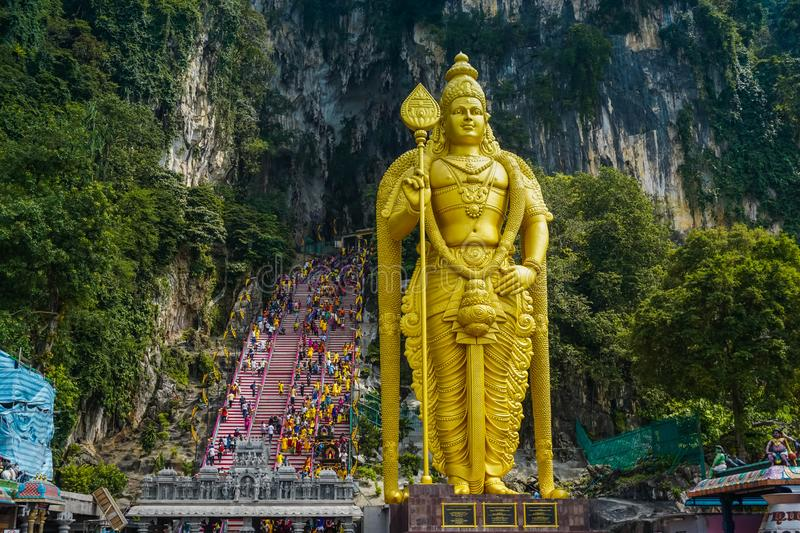 Entrance to Batu Cave and statue of God Morugan. Kuala Lumpur, Malaysia. South East Asia royalty free stock image
