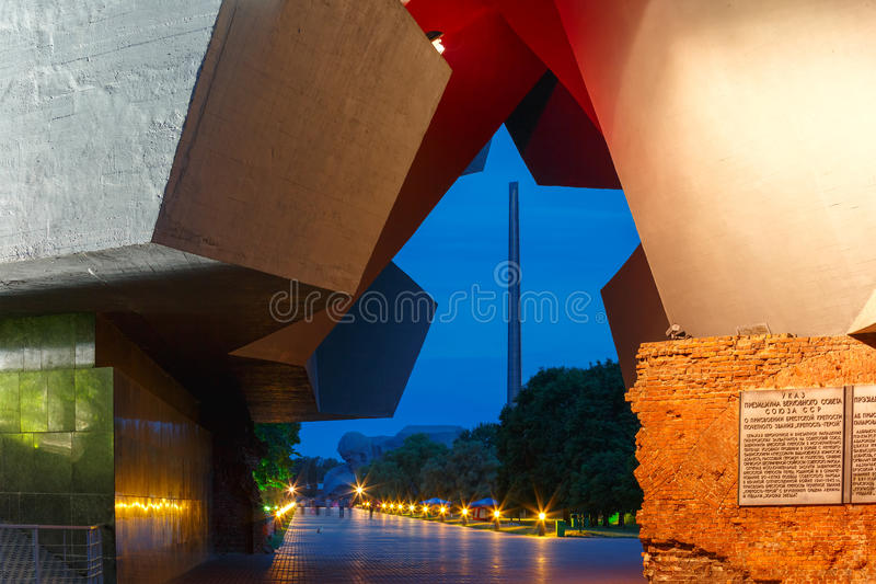 Entrance to Brest fortress at night, Belarus. Main entrance to Brest fortress with carved five-pointed star in night illumination - view from the gates to the royalty free stock image